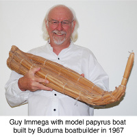 Guy Immega with model  papyrus boat built by Buduma boatbuilder